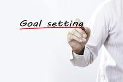 Στόχος γραψίματος χεριών επιχειρηματιών που θέτει με το δείκτη, επιχείρηση συμπυκνωμένη Στοκ εικόνες με δικαίωμα ελεύθερης χρήσης