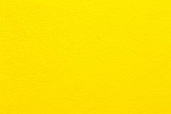Συγκεκριμένη κίτρινη ανασκόπηση τοίχων. Στοκ Φωτογραφίες