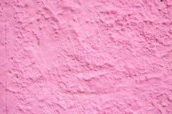 Συγκεκριμένος κατασκευασμένος τοίχος που χρωματίζεται με το ρόδινο χρώμα Στοκ φωτογραφία με δικαίωμα ελεύθερης χρήσης