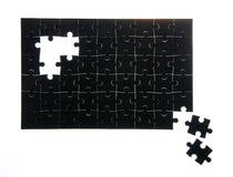 Συγκεντρωμένος μαύρος γρίφος χωρίς μερικά στοιχεία στοκ εικόνα