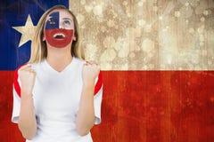 Συγκινημένος ανεμιστήρας της Χιλής στο χρώμα προσώπου ενθαρρυντικό Στοκ Εικόνες