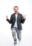 Συγκινημένος επιτυχής νεαρός άνδρας που φωνάζει και νίκη εορτασμού Στοκ Εικόνες