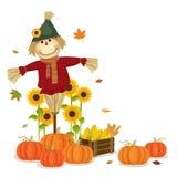 Συγκομιδή φθινοπώρου με το χαριτωμένες σκιάχτρο και τις κολοκύθες Στοκ Φωτογραφίες