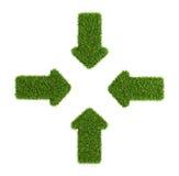 Συγκλίνον σύμβολο βελών από τη χλόη Στοκ Εικόνες