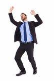 Συγκλονισμένος επιχειρηματίας που στέκεται και που ωθεί επάνω Στοκ Εικόνα