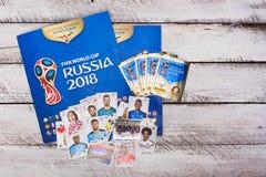 Συλλέξιμα αυτοκόλλητες ετικέττες και λεύκωμα Panini για το ποδόσφαιρο W της Ρωσίας 2018 Στοκ Φωτογραφίες
