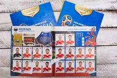 Συλλέξιμα αυτοκόλλητες ετικέττες και λεύκωμα Panini για το ποδόσφαιρο W της Ρωσίας 2018 Στοκ Εικόνα
