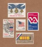 Συλλογή των εκλεκτής ποιότητας γραμματοσήμων αμερικανικής ταχυδρομικής υπηρεσίας που τιμούν τους παλαιμάχους Στοκ Εικόνες