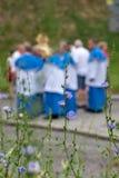 Συμμετέχοντες που συμμετέχουν στη γιορτή της καθολικής εκκλησίας του Corpus Christi, στην παλαιά πόλη της Κρακοβίας, Πολωνία στοκ εικόνες