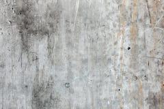 Συμπαγής τοίχος σύστασης με τις ραβδώσεις της σκουριάς και των αριθμών Στοκ φωτογραφία με δικαίωμα ελεύθερης χρήσης