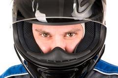 Συναγωνιμένος οδηγός με το κράνος Στοκ Φωτογραφίες