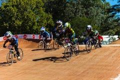 Συναγωνιμένος υπήκοοι αγοριών BMX Στοκ Φωτογραφίες