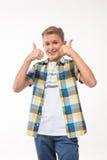 Συναισθηματικό αγόρι σε ένα πουκάμισο καρό Στοκ Εικόνες