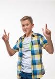 Συναισθηματικό αγόρι σε ένα πουκάμισο καρό Στοκ εικόνα με δικαίωμα ελεύθερης χρήσης