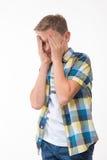 Συναισθηματικό αγόρι σε ένα πουκάμισο καρό Στοκ Εικόνα