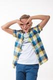 Συναισθηματικό αγόρι σε ένα πουκάμισο καρό Στοκ Φωτογραφίες