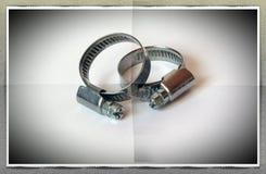 συνδετήρες για το σωλήνα στοκ εικόνα