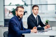 Συνεδρίαση επιχειρηματιών στην επιχειρησιακή συνεδρίαση Στοκ εικόνα με δικαίωμα ελεύθερης χρήσης