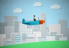 Συνεδρίαση επιχειρηματιών στο μικρό αεροπλάνο προωστήρων στοκ φωτογραφίες