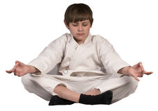 Συνεδρίαση αγοριών meditates στη Kim Στοκ Εικόνες