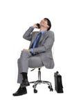 Συνεδρίαση ατόμων σε μια καρέκλα στοκ φωτογραφία