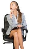 Συνεδρίαση επιχειρηματιών στην καρέκλα γραφείων με Στοκ Φωτογραφία