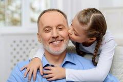 Συνεδρίαση παππούδων με το εγγόνι του Στοκ Εικόνες