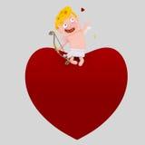 Συνεδρίαση Cupid σε μια μεγάλη καρδιά Στοκ Εικόνα
