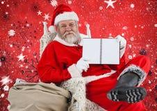 Συνεδρίαση Santa στην καρέκλα και παρουσίαση ημερολογίου Στοκ Εικόνα