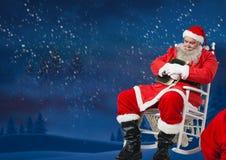 Συνεδρίαση Santa στην καρέκλα και ύπνος Στοκ Εικόνα