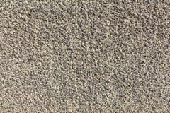 Συντριμμένο αμμοχάλικο στην επικονιασμένη τοίχος σύσταση τσιμέντου Στοκ Εικόνα
