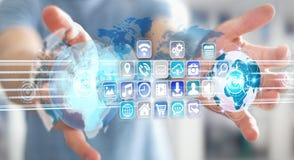 Συνδέοντας κόσμοι επιχειρηματιών στα προγράμματα εικονιδίων και εφαρμογών Στοκ Φωτογραφία