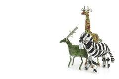 Συνδεμένη με καλώδιο και διακοσμημένη με χάντρες αφρικανική ζωική τέχνη ενός με ραβδώσεις, girafe και buc Στοκ Φωτογραφίες