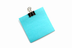 Συνδετήρες και μπλε σημείωση Στοκ εικόνα με δικαίωμα ελεύθερης χρήσης