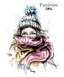 Συρμένη η χέρι όμορφη νέα γυναίκα πλέκει μέσα την ΚΑΠ Ο μοντέρνος χειμώνας κοιτάζει Γυναίκα μόδας με το μαντίλι απεικόνιση αποθεμάτων