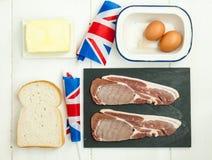 Συστατικά σάντουιτς αυγών και μπέϊκον με τη βρετανική σημαία Στοκ Φωτογραφία