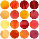 Συλλογή κύκλων Watercolor στα κίτρινα και κόκκινα χρώματα στοκ φωτογραφία