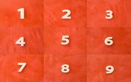 Συλλογή του άσπρου αριθμού στο κόκκινο Στοκ φωτογραφία με δικαίωμα ελεύθερης χρήσης
