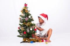 συλλογή Χριστουγέννων παιχνιδιού αγοριών Στοκ Φωτογραφίες