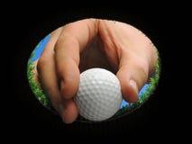 Σφαίρα γκολφ εκμετάλλευσης χεριών Στοκ Φωτογραφία