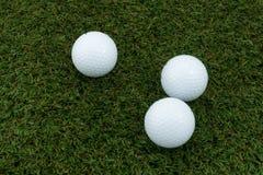 σφαίρα γκολφ τρία Στοκ Φωτογραφίες