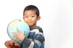 Σφαίρα και ιαπωνικό αγόρι Στοκ Εικόνα