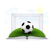 Σφαίρα και πύλη ποδοσφαίρου σε ένα ανοικτό άσπρο βιβλίο Στοκ εικόνα με δικαίωμα ελεύθερης χρήσης