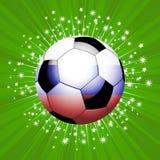 Σφαίρα ποδοσφαίρου ποδοσφαίρου κόκκινοι μπλε και άσπρος στην έκρηξη αστεριών Στοκ φωτογραφία με δικαίωμα ελεύθερης χρήσης