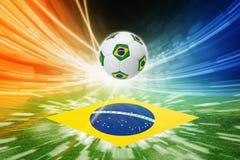 Σφαίρα ποδοσφαίρου και σημαία της Βραζιλίας Στοκ Φωτογραφία