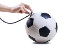 Σφαίρα ποδοσφαίρου με το χέρι και το στηθοσκόπιο Στοκ εικόνες με δικαίωμα ελεύθερης χρήσης