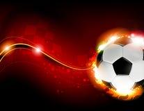 Σφαίρα ποδοσφαίρου στο κόκκινο υπόβαθρο Στοκ εικόνες με δικαίωμα ελεύθερης χρήσης