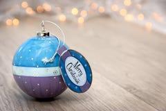 Σφαίρα Χριστουγέννων με την επιθυμία Χαρούμενα Χριστούγεννας Στοκ Εικόνες