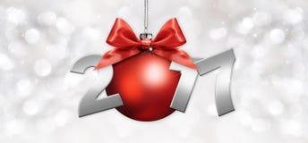 Σφαίρα Χριστουγέννων με το κόκκινο τόξο κορδελλών και κείμενο του 2017 στο ασημένιο blurr απεικόνιση αποθεμάτων