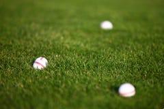 Σφαίρες γκολφ στα gras Στοκ Εικόνα
